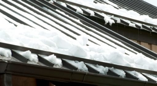 snow bar metal roof with snow 1