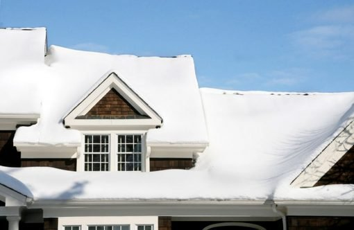 snow piled up on roof structure